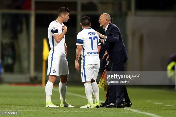 Stefano Pioli manager of FC Internazionale talks to Roberto Gagliaridini and Gary Medelof FC Internazionale during the Serie A match between ACF...