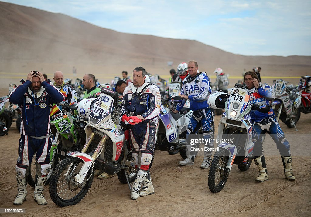 Stefano Rampolla (170) and Jan Bastiaan Nijen Twilhaar (179) wait to start stage 6 from Arica to Calama during the 2013 Dakar Rally on January 10, 2013 in Arica, Chile.