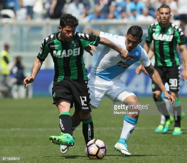 Stefano Sensi of Sassuolo competes for the ball with Allan of Napoli during the Serie A match between US Sassuolo and SSC Napoli at Mapei Stadium...
