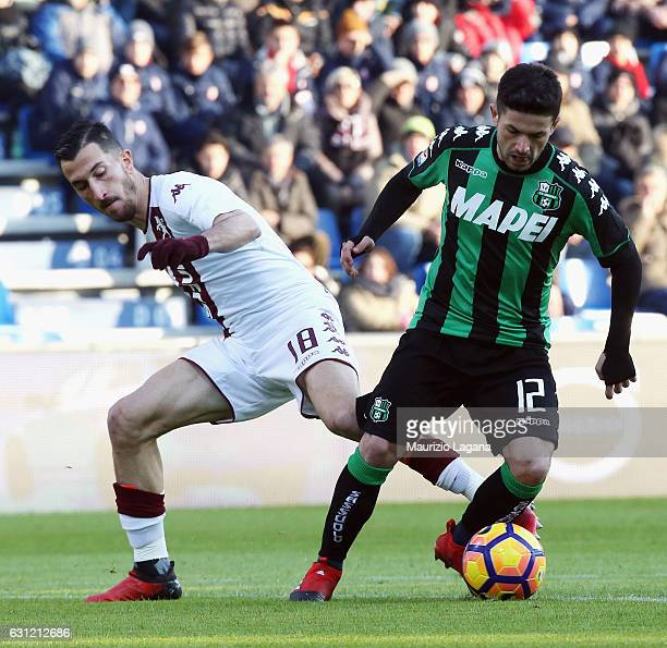 Stefano Sensi of Sassuolo competes for the ball with Mrko Valdifiori of Torino during the Serie A match between US Sassuolo and FC Torino at Mapei...