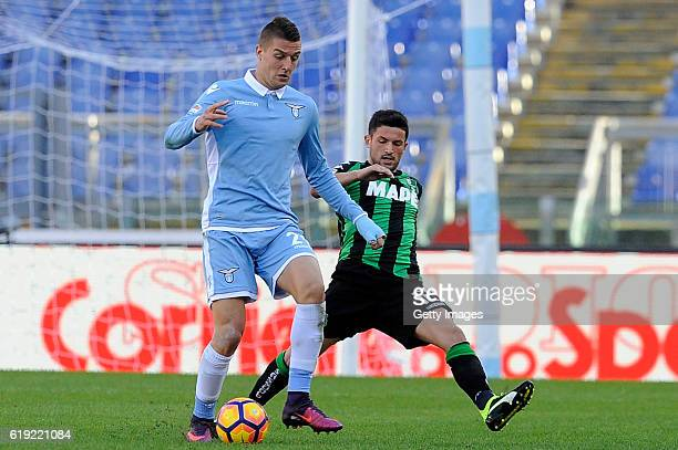 Stefano Sensi of US Sassuolo competes with Sergej Milinkovic Savic of SS Lazio during the Serie A match between SS Lazio and US Sassuolo at Stadio...