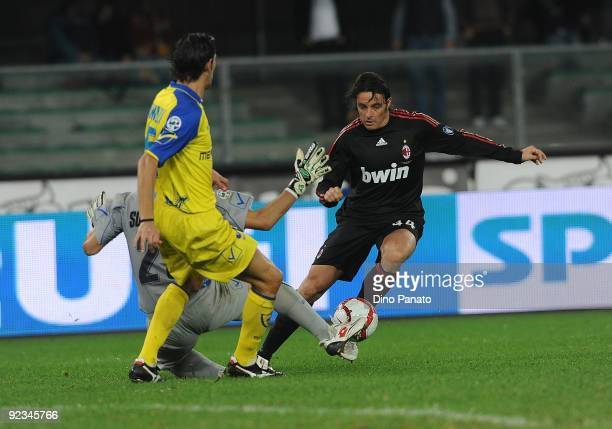 Stefano Sorrentino goalkeeper of AC Chievo Verona saves at the feet of Massimo Oddo of AC Milan during the Serie A match between AC Chievo Verona and...