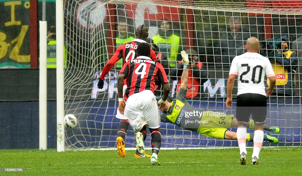 Stefano Sorrentino goalkeeper of US Citta di Palermo fails to save as Mario Balotelli #45 of AC Milan scores a penalty during the Serie A match between AC Milan and US Citta di Palermo at San Siro Stadium on March 17, 2013 in Milan, Italy.