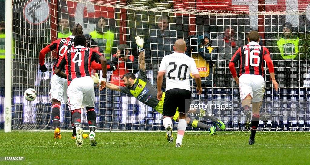 Stefano Sorrentino goalkeeper of US Citta di Palermo fails to save as <a gi-track='captionPersonalityLinkClicked' href=/galleries/search?phrase=Mario+Balotelli&family=editorial&specificpeople=4940446 ng-click='$event.stopPropagation()'>Mario Balotelli</a> #45 of AC Milan scores a penalty during the Serie A match between AC Milan and US Citta di Palermo at San Siro Stadium on March 17, 2013 in Milan, Italy.