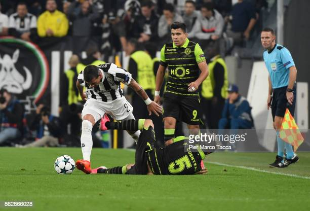 Stefano Sturaro of Juventus competes for the ball with Fabio Coentrao of Sporting CP in action during the UEFA Champions League group D match between...