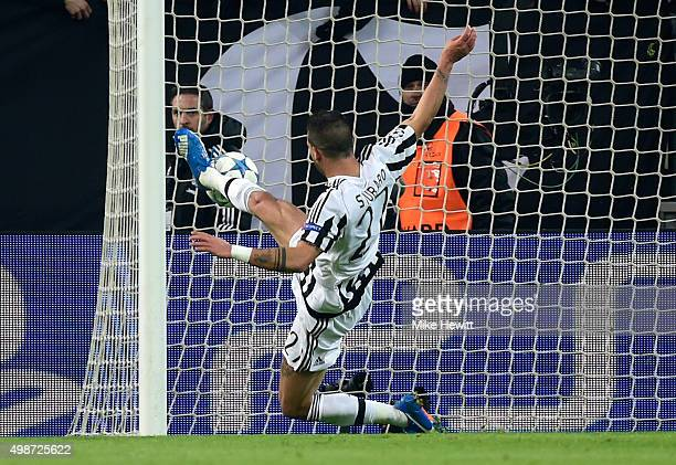 Stefano Sturaro of Juventus fails to score as his shot rebounds off the post during the UEFA Champions League group D match between Juventus and...