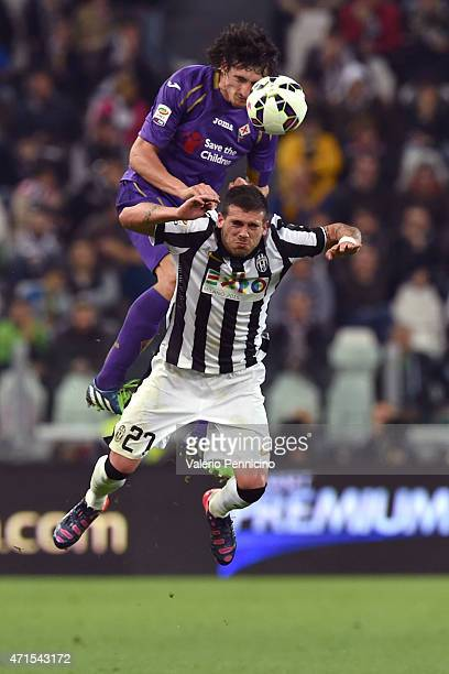 Stefano Sturaro of Juventus FC clashes with Stefan Savic of ACF Fiorentina during the Serie A match between Juventus FC and ACF Fiorentina at...