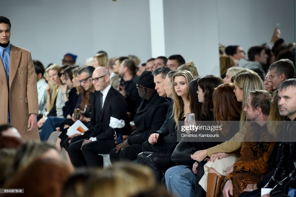 Stefano Tonchi (C) and Abbey Lee Kershaw attend the Calvin Klein Collection Front Row during New York Fashion Week on February 10, 2017 in New York City.