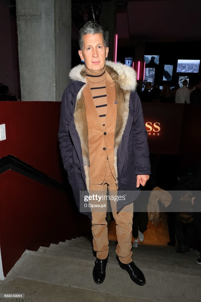 Stefano Tonchi attends the Boss fashion show during