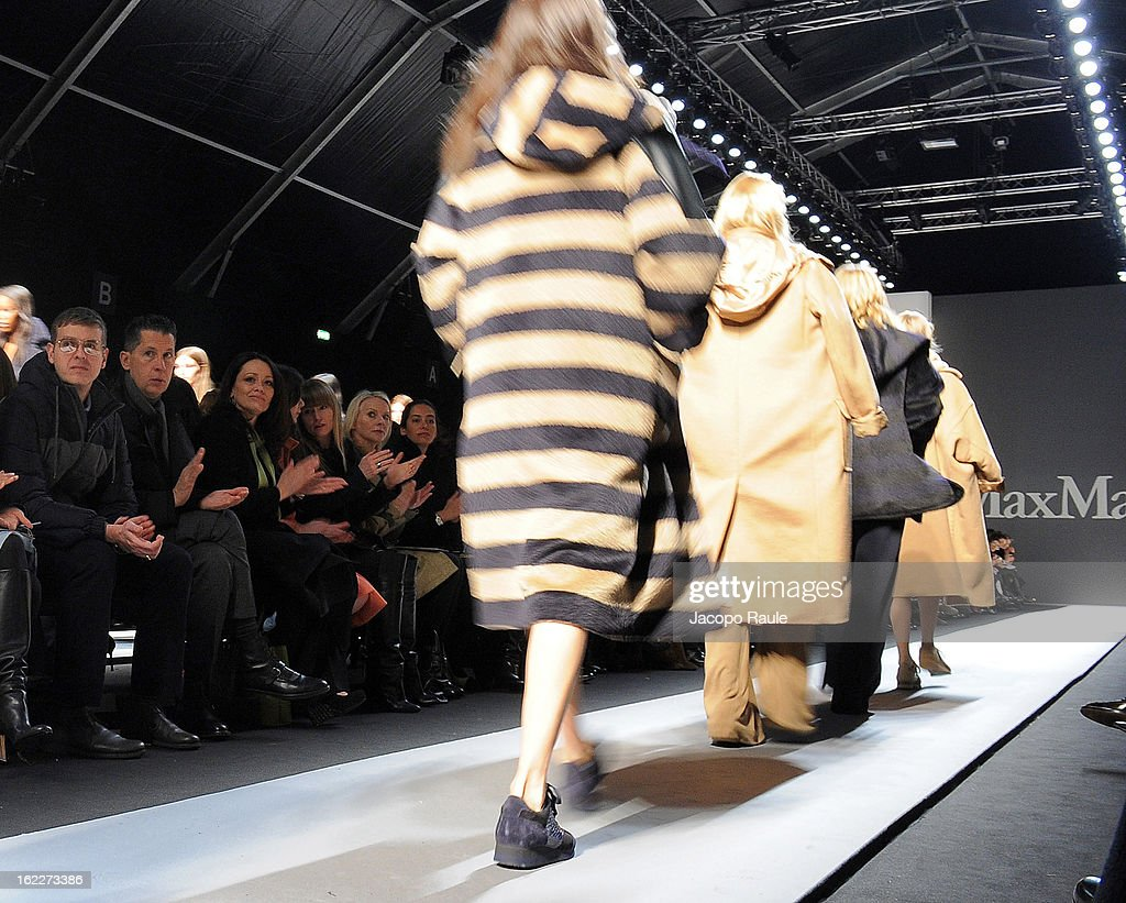 <a gi-track='captionPersonalityLinkClicked' href=/galleries/search?phrase=Stefano+Tonchi&family=editorial&specificpeople=2497117 ng-click='$event.stopPropagation()'>Stefano Tonchi</a> (2nd L) attends the Max Mara fashion show during Milan Fashion Week Womenswear Fall/Winter 2013/14 on February 21, 2013 in Milan, Italy.