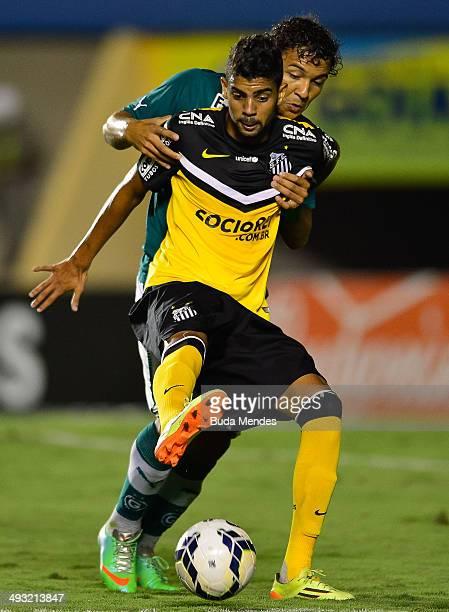 Stefano Yuri of Santos struggles for the ball with Alex Alves of Goias during a match between Goias and Santos as part of Brasileirao Series A 2014...