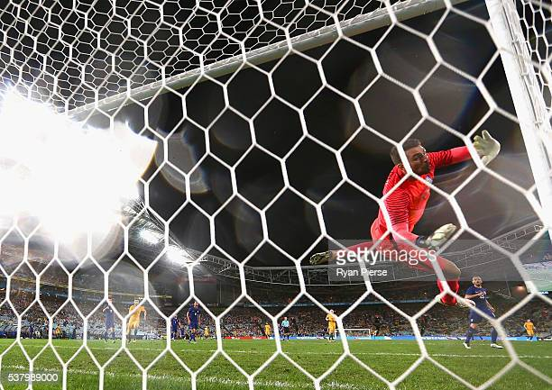 Stefanos Kapino of Greece dives to make a save before collding with the post during the international friendly match between the Australian Socceroos...