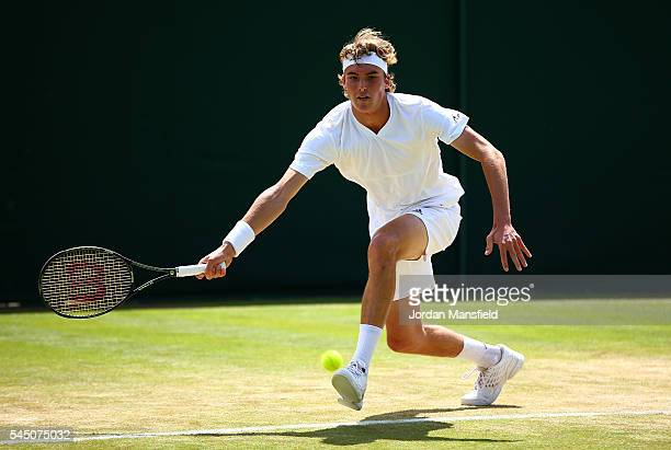 Stefanos Tsitsipas of Greece in action during the Boy's Singles first round match against Vasil Kirkov of The United States on day eight of the...