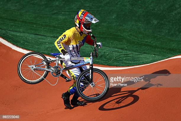 Stefany Hernandez of Venezuela carries her bike too the finish line during the Women's Semi Finals on day 14 of the Rio 2016 Olympic Games at the...