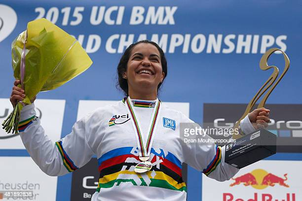 Stefany Hernandez of Venezuela celebrates with her gold medal on the podium after winning the Women Elite motos during day 5 of the UCI BMX World...