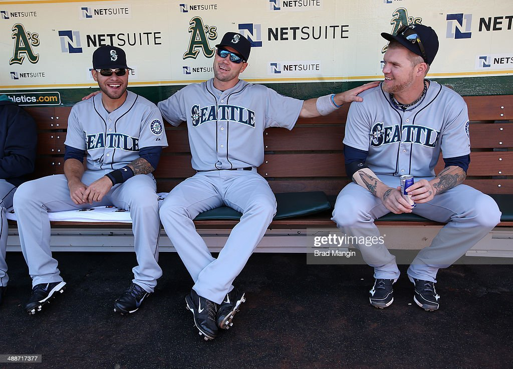Stefen Romero #7, Cole Gillespie #16, and Corey Hart #27 of the Seattle Mariners laugh in the dugout before game one of a doubleheader against the Oakland Athletics at O.co Coliseum on Wednesday, May 7, 2014 in Oakland, California.