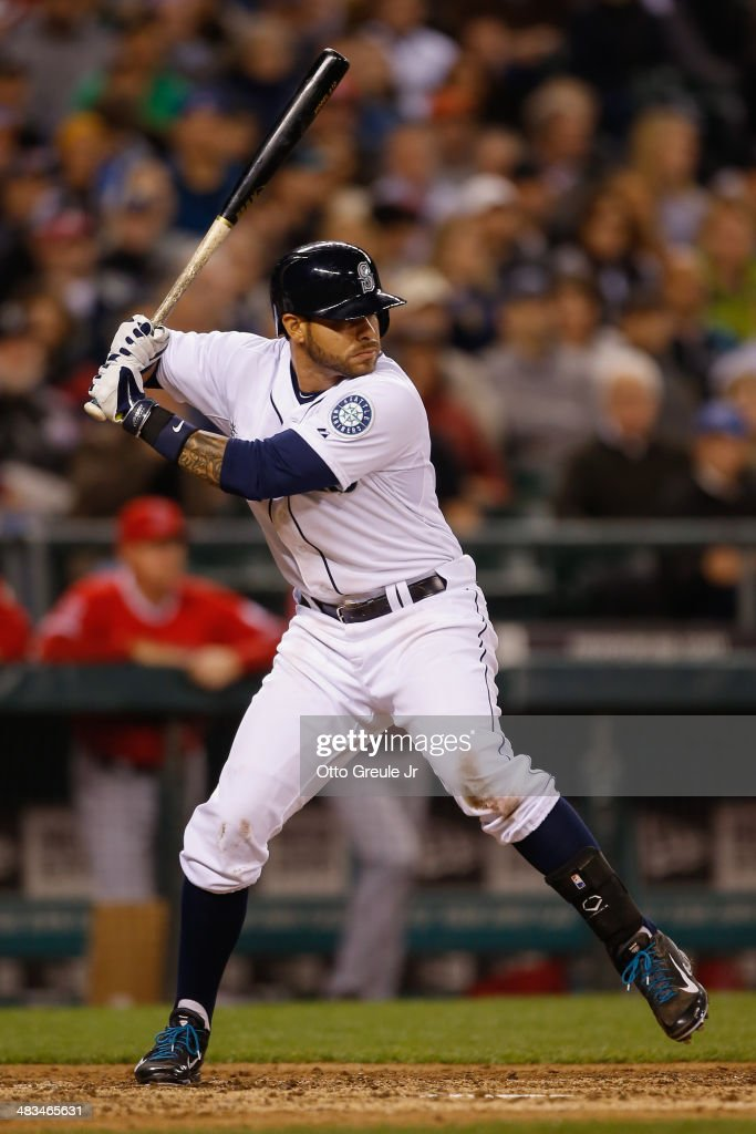 Stefen Romero #7 of the Seattle Mariners bats in the fourth inning against the Los Angeles Angels of Anaheim on Opening Day at Safeco Field on April 8, 2014 in Seattle, Washington.