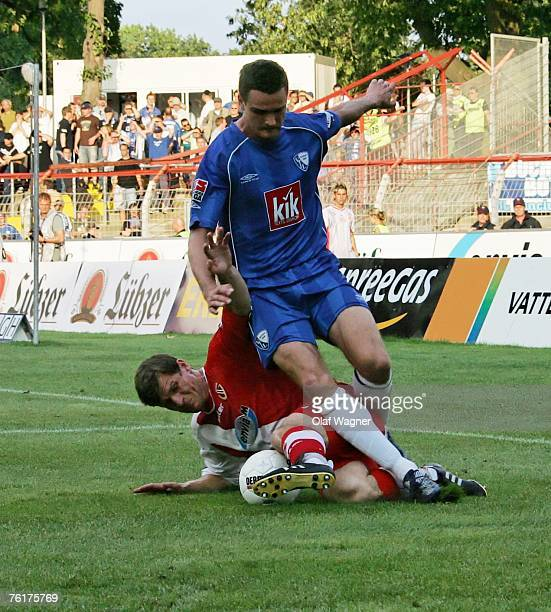 Steffen Baumgart of Cottbus battle for the ball with Marcel Maltitz of Bochum during the Bundesliga match between Energie Cottbus and VfL Bochum at...