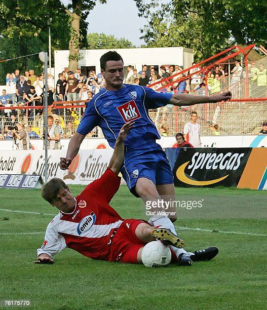 Steffen Baumgart of Cottbus battles for the ball with Marcel Maltitz of Bochum during the Bundesliga match between Energie Cottbus and VfL Bochum at...