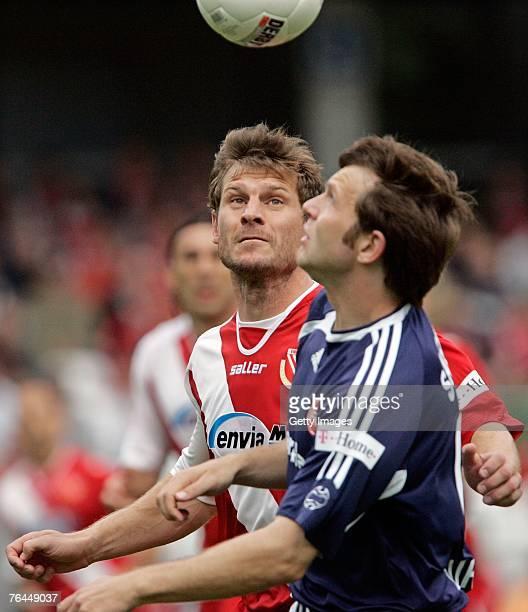 Steffen Baumgart of Energie Cottbus and Ivan Saenko of Nuremberg are seen in action during the Bundesliga match between FC Energie Cottbus v 1 FC...