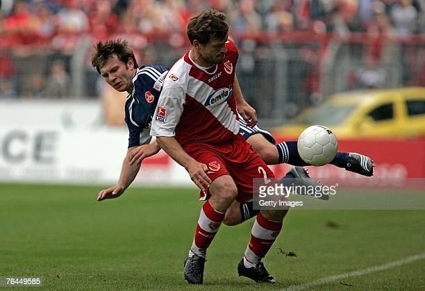 Steffen Baumgart of Energie Cottbus challenges Ivan Saenko of Nuremberg during the Bundesliga match between FC Energie Cottbus v 1 FC Nuremberg at...