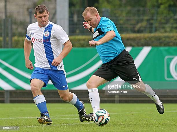 Steffen Baumgart of Rostock battles for the ball with Peter Seitel of Hoechst Classique during the DFB over 40 and over 50 cup at Stadion am...