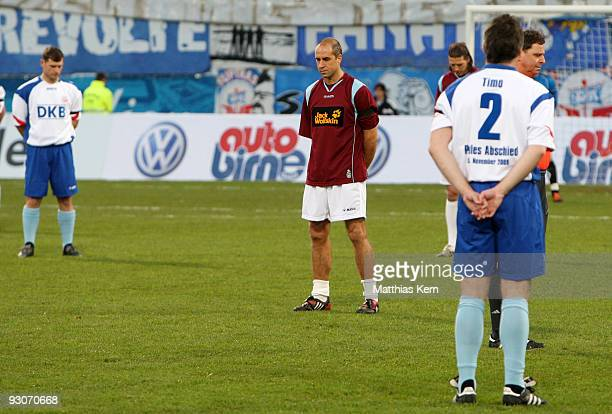 Steffen Baumgart Stefan Beinlich and Timo Lange stand up for a minute's silence after the death of goalkeeper Robert Enke prior to the Stefan...