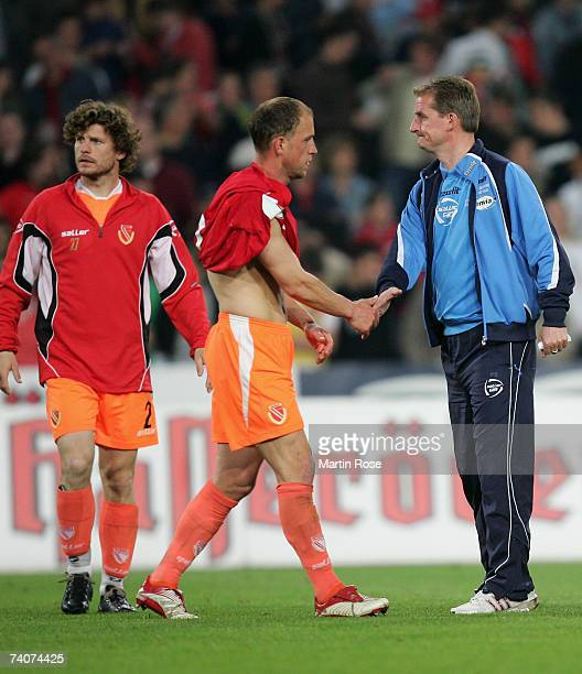 Steffen Baumgart Timo Rost and headcoach Petrik Sander of Cottbus look dejected after losing the Bundesliga match between Hanover 96 and Energie...