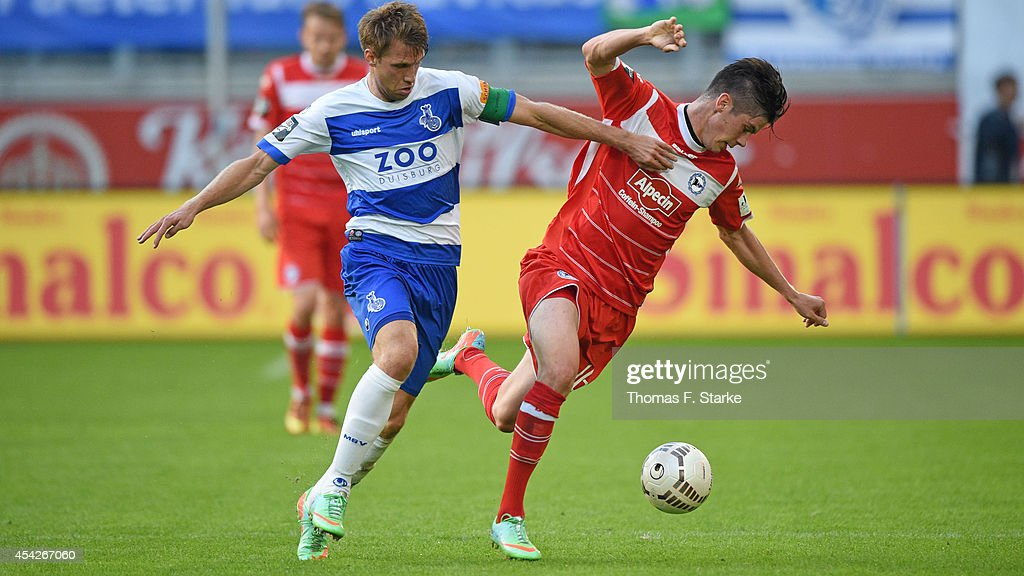 Steffen Bohl (L) of Duisburg and Dennis Mast of Bielefeld fight for the ball during the Third League match between MSV Duisburg and Arminia Bielefeld at Schauinsland-Reisen-Arena on August 27, 2014 in Duisburg, Germany.