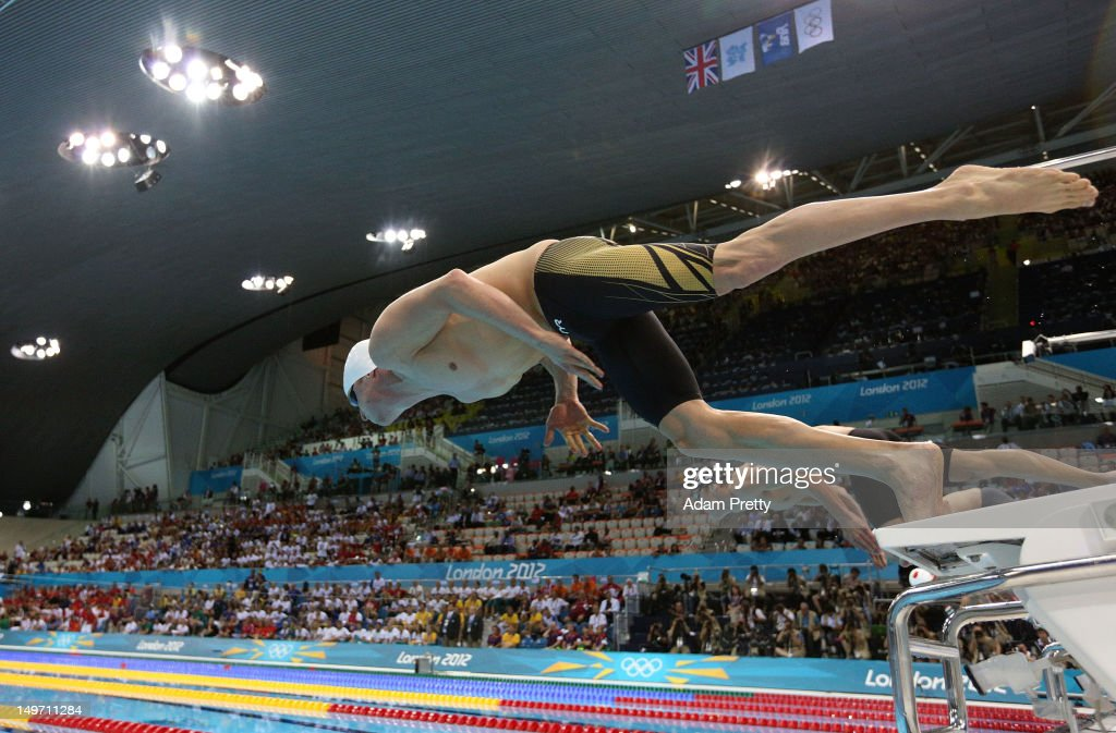 Steffen Diebler of Germany and <a gi-track='captionPersonalityLinkClicked' href=/galleries/search?phrase=Michael+Phelps&family=editorial&specificpeople=162698 ng-click='$event.stopPropagation()'>Michael Phelps</a> of the United States compete in the Men's 100m Butterfly semi final 1 on Day 6 of the London 2012 Olympic Games at the Aquatics Centre on August 2, 2012 in London, England.