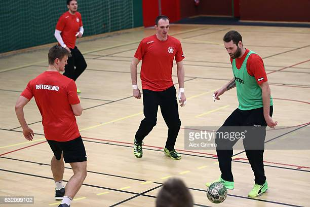 Steffen Faeth is challenged by Holger Glandorf and Niclas Pieczkowski during a Germany training session at Germinal during the 25th IHF Men's World...