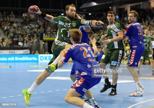 Steffen Faeth of Fuechse Berlin and Christopher Bissel of HC Erlangen during the game between Fuechse Berlin and the HC Erlangen on September 12 2017...