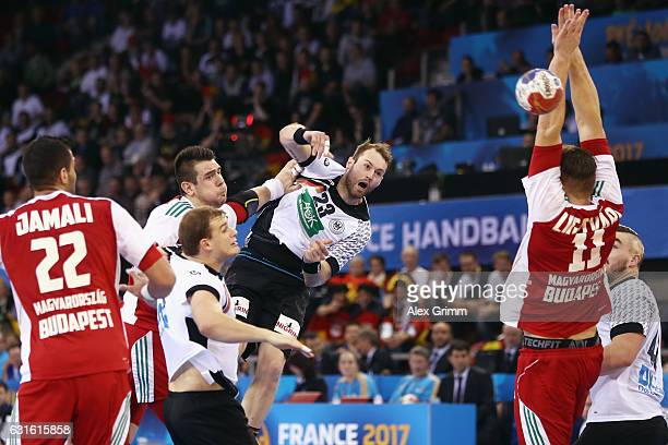 Steffen Faeth of Germany takes a shot on the goal during the 25th IHF Men's World Championship 2017 match between Germany and Hungary at Kindarena on...