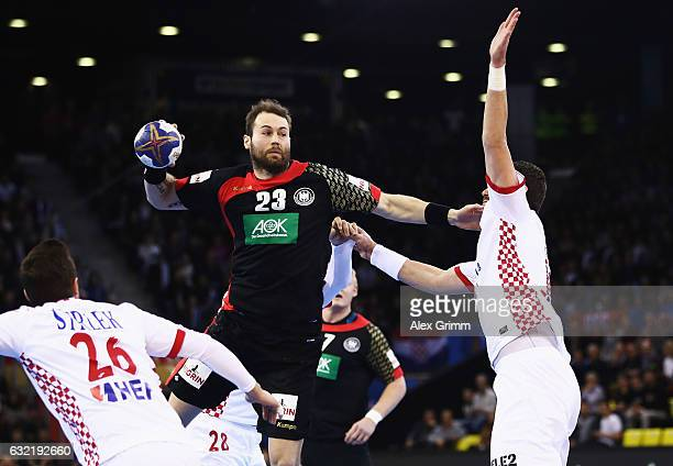 Steffen Fath of Germany is challenged by Jakov Gojun of Croatia during the 25th IHF Men's World Championship 2017 match between Germany and Croatia...
