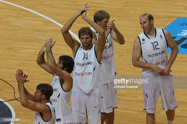 Steffen Hamann Johannes Herber Dirk Nowitzki JanHendrik Jagla and Chris Kaman of Germany celebrate the 7367 victory after the EuroBasket 2011 second...
