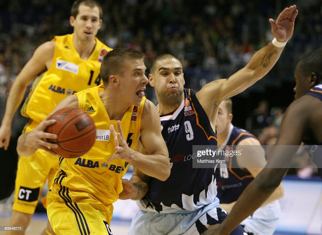 Steffen Hamann of Berlin challenges for the ball with Jeb Ivey of Bremerhaven during the Basketball Bundesliga match between Alba Berlin and...