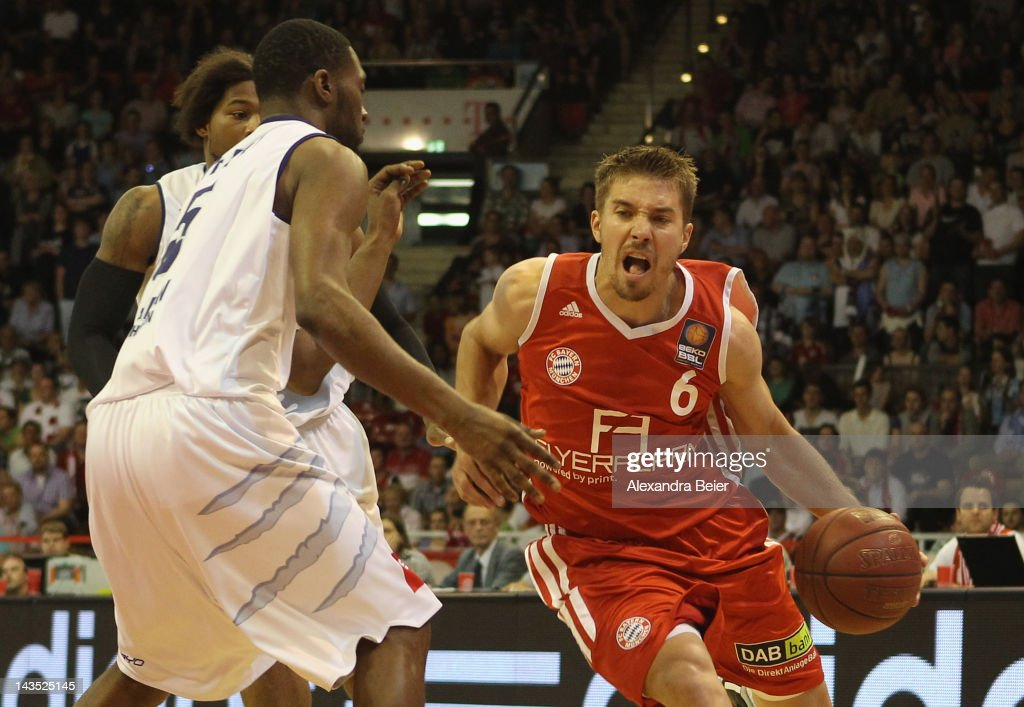 Steffen Hamann of Muenchen fights for the ball with Terrell Everett of Bremerhaven during the Beko Basketball match between FC Bayern Muenchen and on...