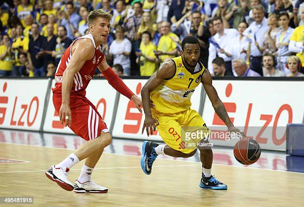 Steffen Hamann of Munich and Dru Joyce of Oldenburg run for the ball during game four of the 2014 Beko BBL Playoffs SemiFinal between EWE Baskets...