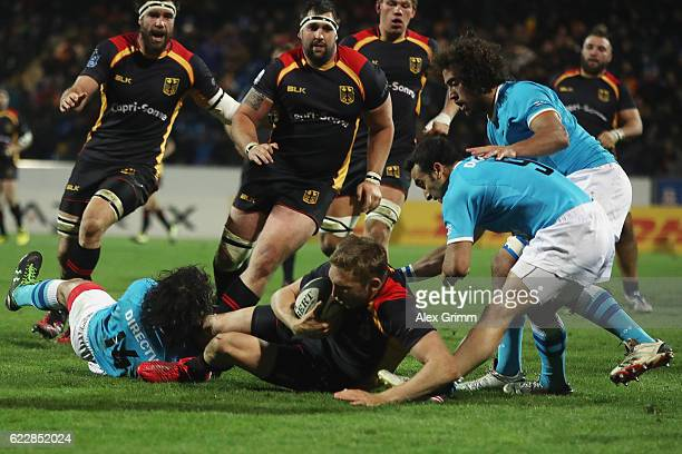 Steffen Liebig of Germany is challenged by Rodrigo Silva of Uruguay during an international match between Germany and Uruguay at Frankfurter...