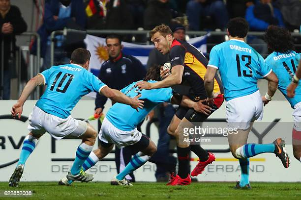 Steffen Liebig of Germany is tackled during an international match between Germany and Uruguay at Frankfurter VolksbankStadion on November 12 2016 in...