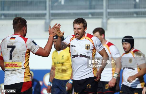 Steffen Liebig of Germany shakes hands with Sebastian Ferreira during the European Shield Rugby match between Germany and Romania at...