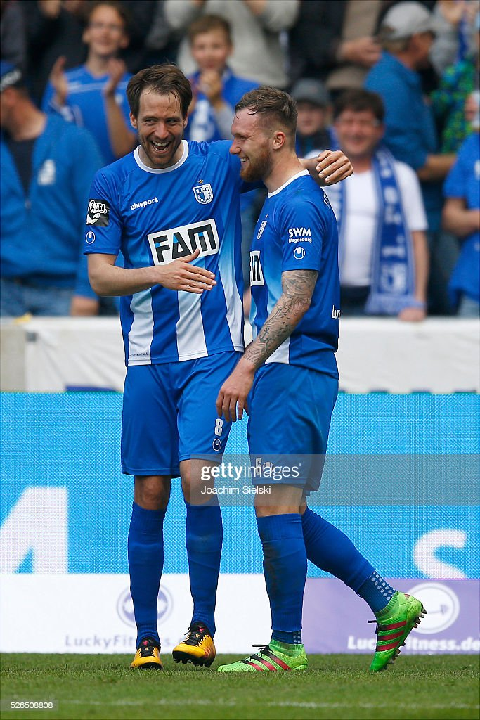 Steffen Puttkammer and Goalgetter Jan Loehmannsroeben of Magdeburg celebration the goal 4:0 for Magdeburg during the Third League match between 1. FC Magdeburg and SG Sonnenhof-Grosssaspach at MDCC-Arena on April 30, 2016 in Magdeburg, Germany.