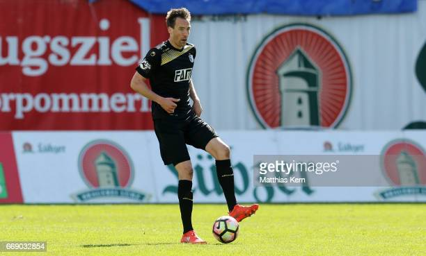 Steffen Puttkammer of Magdeburg runs with the ball during the third league match between FC Hansa Rostock and 1FC Magdeburg at Ostseestadion on April...
