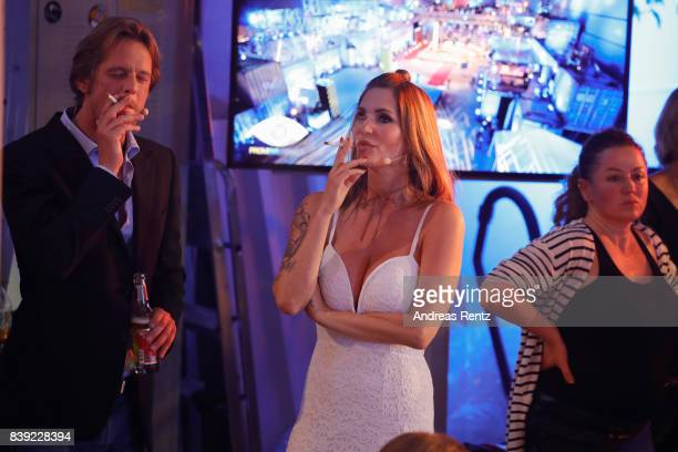 Steffen von der Beeck and Sarah Kern smoke a cigarette during the finals of 'Promi Big Brother 2017' at MMC Studio on August 25 2017 in Cologne...