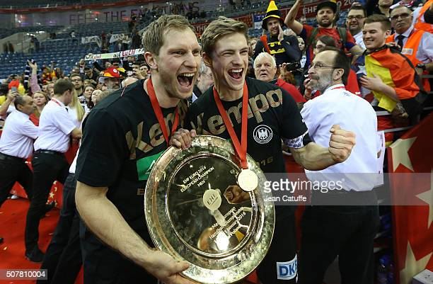 Steffen Weinhold and Rune Dahmke of Germany celebrate the victory following the Gold Medal match the final of the Men's EHF European Handball...