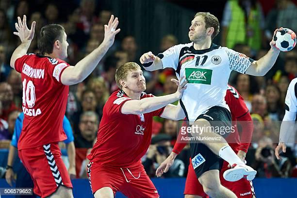 Steffen Weinhold from Germany throws the ball against Aleksandr Chernoivanov from Russia during the Men's EHF Handball European Championship 2016...