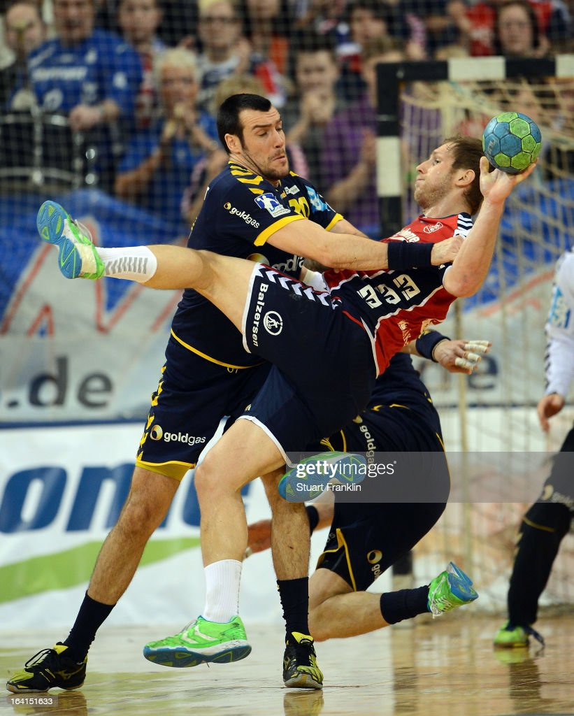 Steffen Weinhold of Flensburg is challenged by Gedeon Guardiola of Rhein-Neckar during the Toyota Bundesliga handball game between SG Flensburg-Handewitt and Rhein-Neckar Loewen at the Flens arena on March 20, 2013 in Flensburg, Germany.