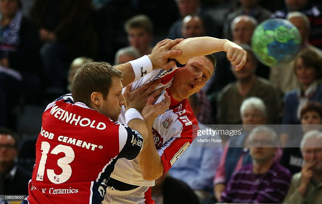Steffen Weinhold of Flensburg (L) is challenged by Stian Toennesen (R) of Magdeburg during the DKB Handball Bundesliga match between SG Flensburg-Handewitt and SC Magdeburg at Campus Hall on November 13, 2012 in Flensburg, Germany.