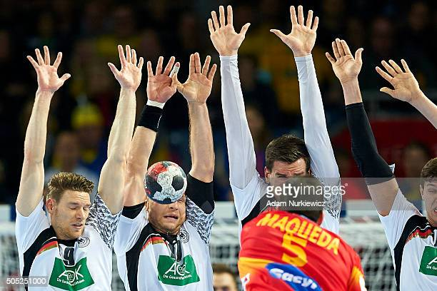 Steffen Weinhold of Germany is hit in his face while blocking a shot of Jorge Maqueda of Spain during the Men's EHF Handball European Championship...