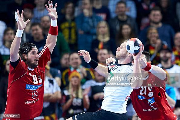 Steffen Weinhold of Germany throws the ball against Laszlo Nagy of Hungary during the Men's EHF Handball European Championship 2016 match between...